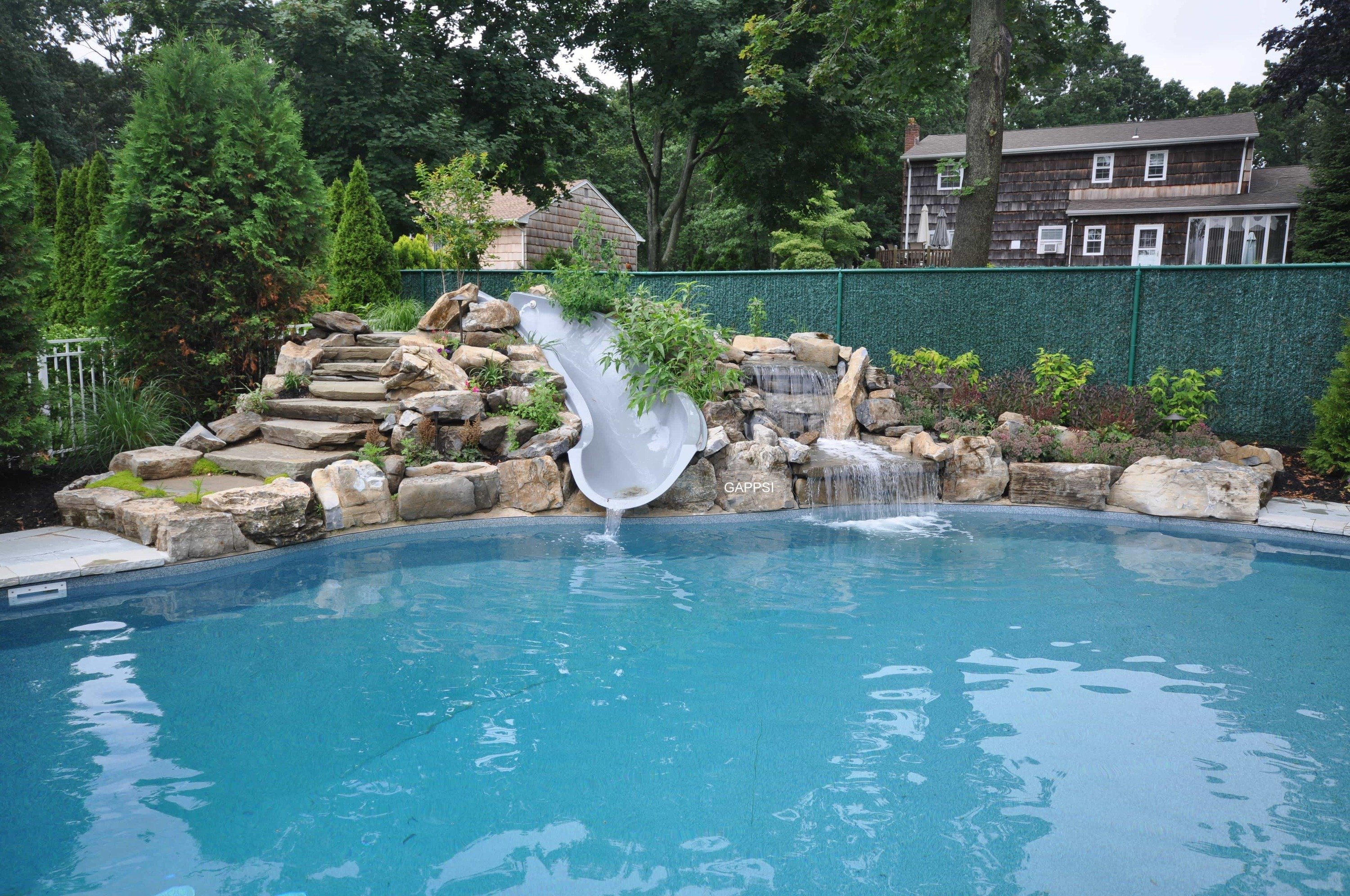 https://gappsi.com/wp-content/uploads/2014/02/Swimming-pool-Backyard-Waterfalls-Long-Island-contractor-Gappsi.jpg