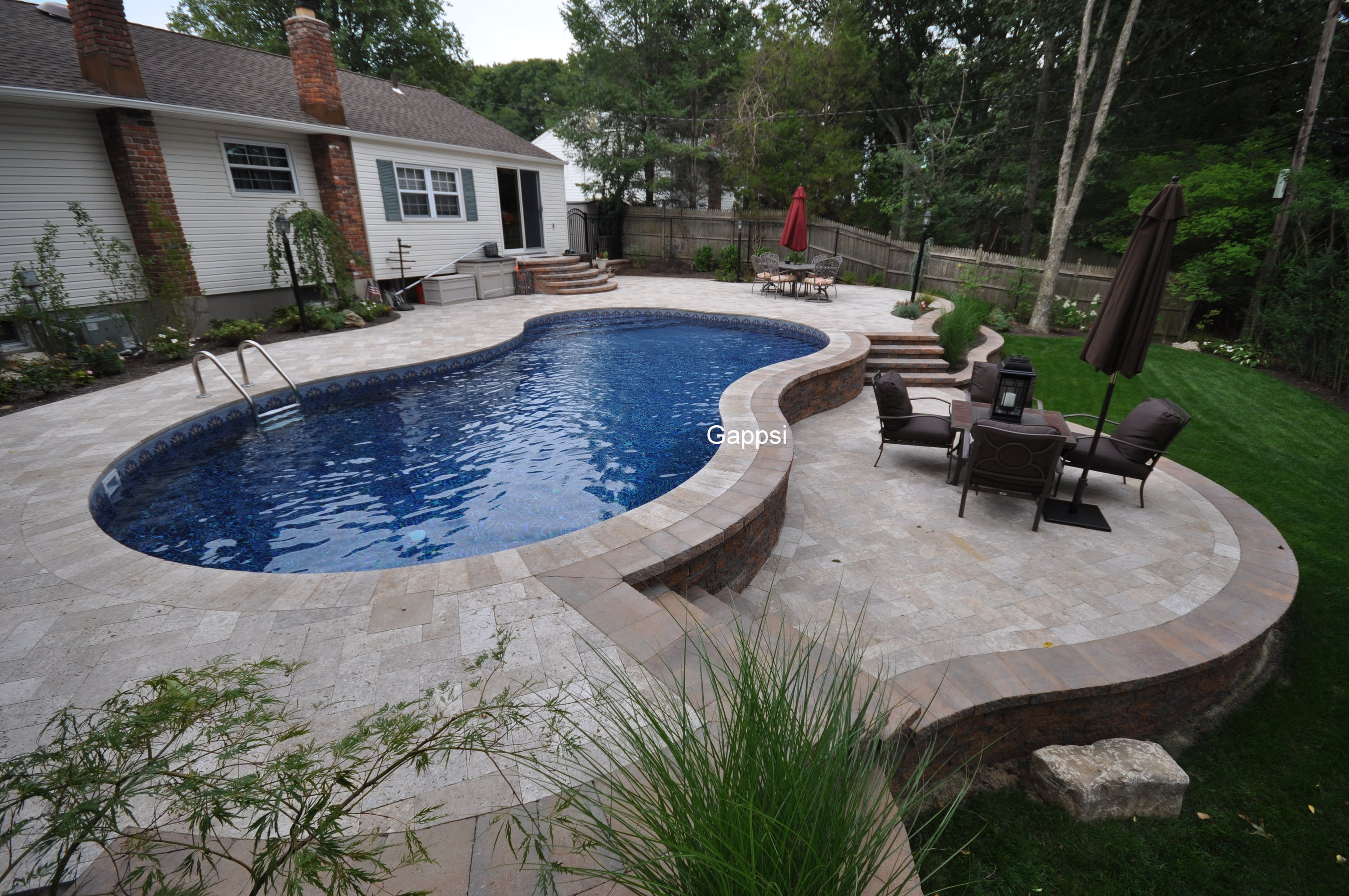 Swimming pool built in hill in smithtown ny by Gappsi