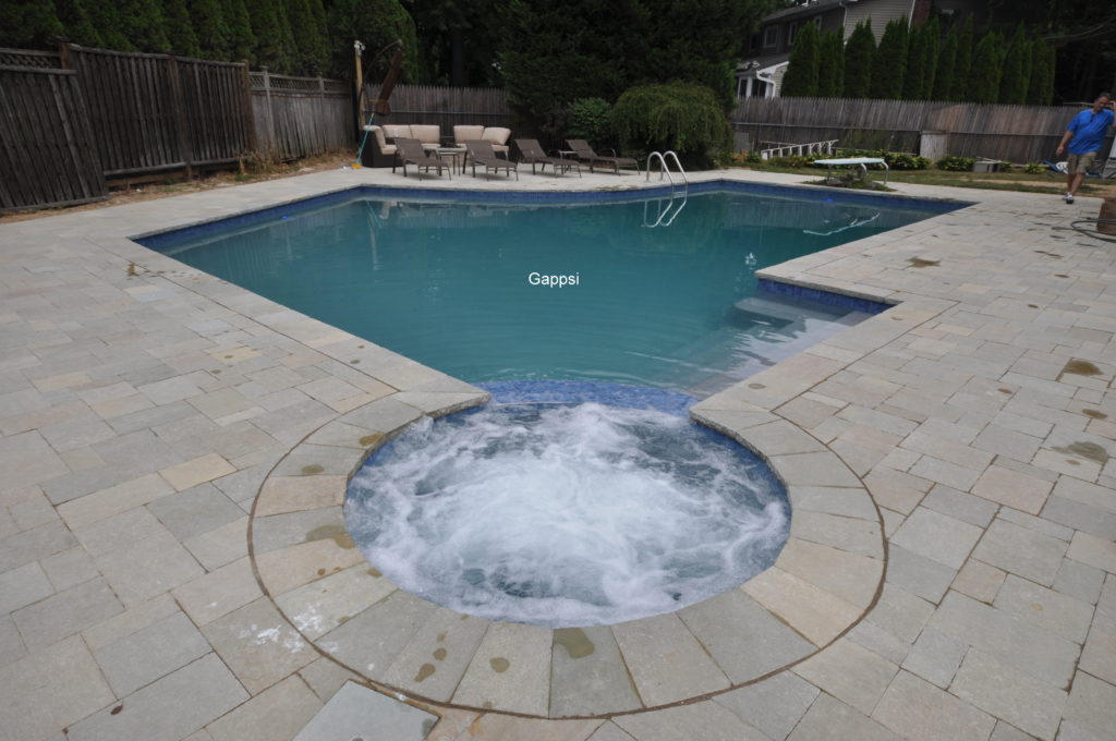 Limestone pavers installed for pool patio and coping in East Northport NY